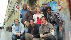staff in front of the hostel